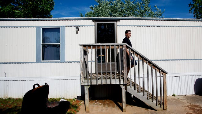 Jorge Mendez descends the stairs of his mobile home to prepare his grill to make dinner May 1, 2017.