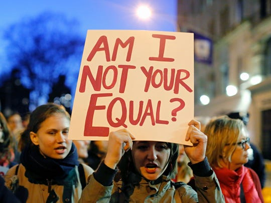 Demonstrators for women's rights gather for an International