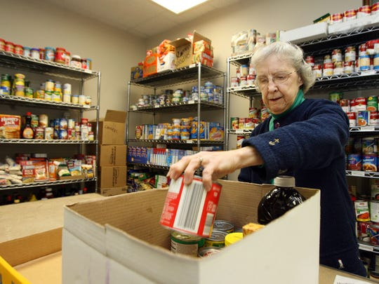 Volunteer Jean Gilbert, of Johnston, fills up a box