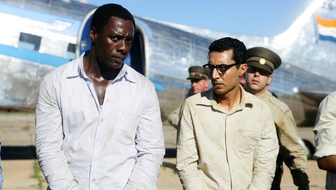 Idris Elba, left, as Nelson Mandela, and Riaad Moosa, as Ahmed Kathrada, in the film 'Mandela: Long Walk to Freedom.'