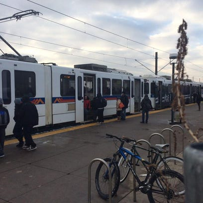 Passengers at the Alameda light rail station