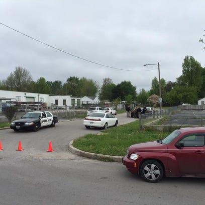 Police surround house on N Missouri Avenue