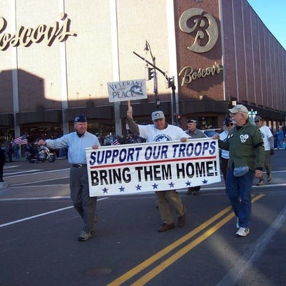Veterans for Peace members marching in a Veterans Day