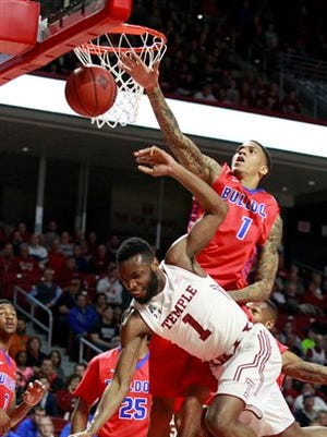 Temple's Josh Brown (1) goes down after being fouled by  Louisiana Tech's Michale  Kyser during the first half of an NCAA college basketball game in the National Invitation Tournament, Wednesday, March 25, 2015 at the Liacouras Center in Philadelphia. (AP Photo/The Philadelphia Inquirer, Charles Fox)  PHIX OUT; TV OUT; MAGS OUT; NEWARK OUT