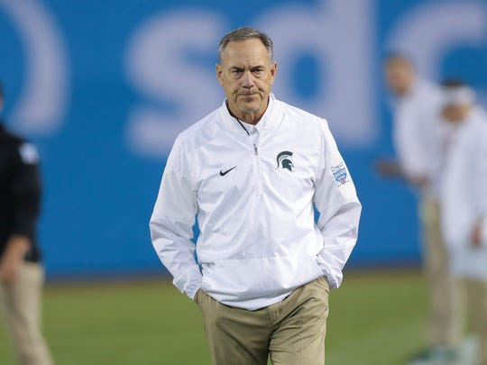 Michigan State coach Mark Dantonio watches his team