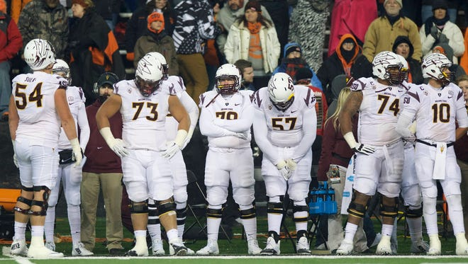The Arizona State football team watch from the sidelines as time runs down during an NCAA college football game against Oregon State in Corvallis, Or., Saturday, Nov. 15, 2014. The Beavers beat the Sun Devils 35-27.