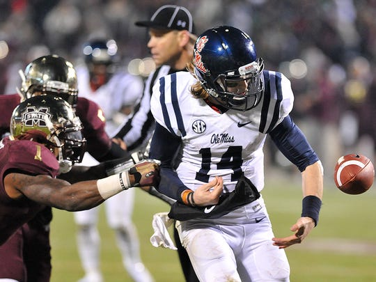 Nickoe Whitley strips Ole Miss quarterback Bo Wallace of the football, giving Mississippi State the Egg Bowl victory last year.