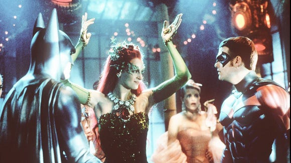 "George Clooney as Batman, left, Uma Thurman as Poison Ivy and Chris O'Donnell as Robin in Warner Bros.' ""Batman & Robin."" (GNS Photo by Christine Loss)"