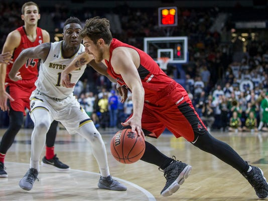 Ball State's Tayler Persons (2) drives by Notre Dame's T.J. Gibbs (10) during the first half of an NCAA college basketball game Tuesday, Dec. 5, 2017, in South Bend, Ind. (AP Photo/Robert Franklin)