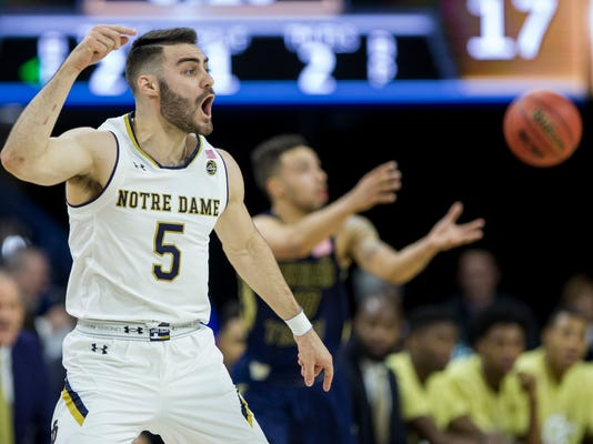 Notre Dame's Matt Farrell yells to teammates during the first half of an NCAA college basketball game against Georgia Tech Saturday, Dec. 30, 2017, in South Bend, Ind. (AP Photo/Robert Franklin)