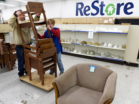 Central Minnesota Habitat for Humanity ReStore volunteers Jessy Rychart and Mari Walker move furniture back to the showroom floor following remodel efforts in January 2016.