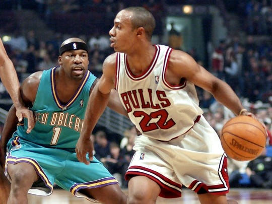 Chicago Bulls' Jay Williams' (22) drives to the basket against New Orleans Hornets' Baron Davis (1) during the first period, Friday, Nov. 1, 2002, in Chicago. (AP Photo/Stephen J. Carrera)