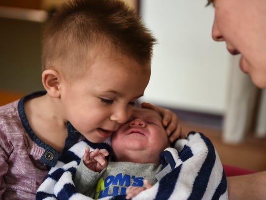 Gabriel Quinones and his baby brother, William, born