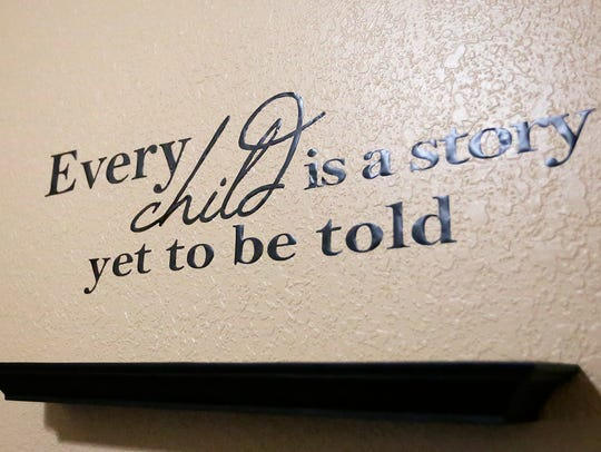 A quote hangs on a wall in the Pillar and Vine building