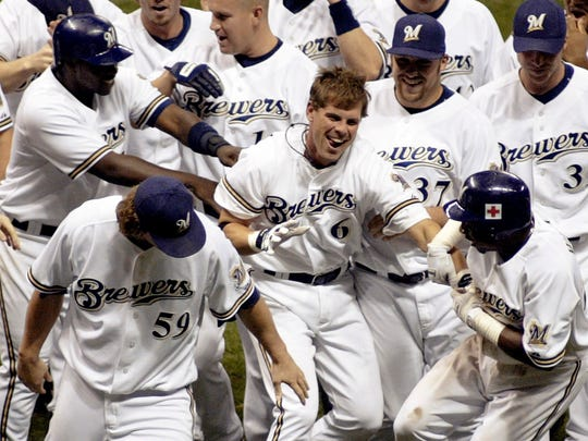 Milwaukee Brewers' pinch hitter Jeff Cirillo (6) is swarmed by teammates after hitting a game-winning RBI single against the Chicago Cubs in the bottom of the ninth inning Wednesday, Sept. 21, 2005, in Milwaukee. The Brewers won 7-6.