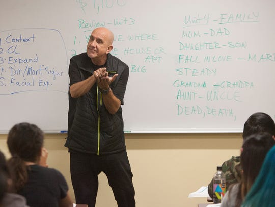 Dave Sladek teaches a sign-language class at Ventura