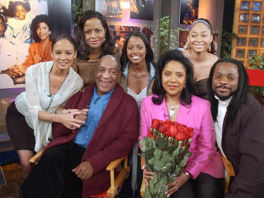 "FILE – In this May 2, 2002, file photo, actors who portrayed Bill Cosby's fictional television family, the Huxtables, on the situation comedy ""The Cosby Show"" pose together in NBC's ""Today"" show studio in New York. From left are Sabrina Le Beauf, Tempestt Bledsoe, Cosby, Keshia Knight Pulliam, Phylicia Rashad, Raven-Symone and Malcolm-Jamal Warner. Cosby's retrial on sexual assault charges is set to begin Monday, April 9, 2018. (AP Photo/Richard Drew, File) ORG XMIT: PAPX403"