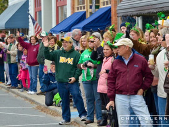Crowds line Market Street during last year's  St. Patrick's Day parade in Onancock.