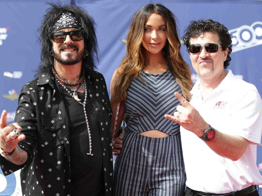 Scott Borchetta, right, poses on the 2017 Indianapolis