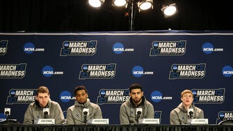 From left: Xavier Musketeers forward Sean O'Mara (54), guard Trevon Bluiett (5), forward Kerem Kanter (11) and guard J.P. Macura (55) answer questions from reporters, Thursday, March 15, 2018, at Bridgestone Arena in Nashville.