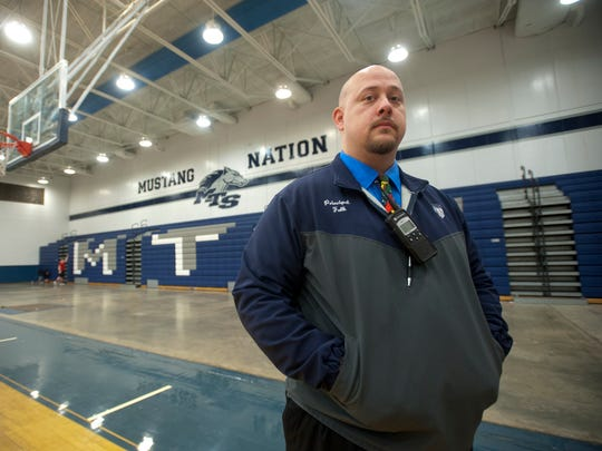 Rob Fulk, principal of Marion C. Moore Middle-High School stands in the school's gym. Jan. 18, 2018