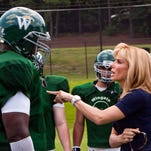 "Quinton Aaron as Michael Oher and Sandra Bullock as Leigh Anne Tuohy in a scene from the motion picture ""The Blind Side.""  Photo by Ralph Nelson, Warner Bros. Pictures  (Via MerlinFTP Drop)"