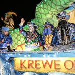 The 2016 Krewe of Lafitte Illuminated Mardi Gras Parade rolls through downtown Friday night.