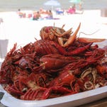 Kick it at the beach for crawfish fest and 5k