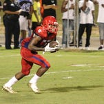 Pine Forest's Jacob Copeland (1) returns a Pensacola kickoff Friday night at Pine Forest High School.