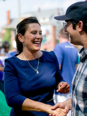 Gubernatorial candidate Gretchen Whitmer works the crowd at a campaign event at Gordon Park in Detroit on  Sunday.