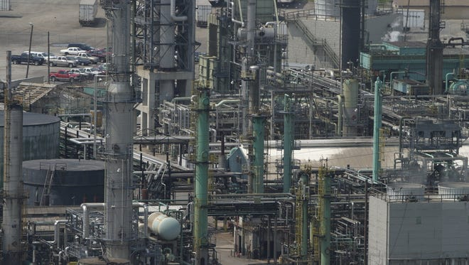 Marathon Oil has asked for permission to increase the emissions of at least eight air pollutants from its Detroit refinery.