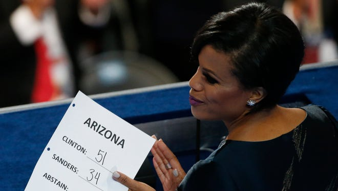 Baltimore mayor and secretary of the Democratic National Committee Stephanie Rawlings-Blake holds state delegate vote totals during roll call on Tuesday, July 26, 2016, in Philadelphia.