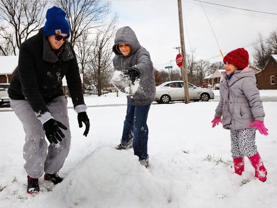 Rachel Bell, left, joined in to help her children,