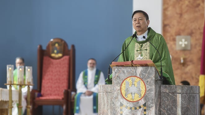 In this file photo, Archbishop Savio Tai Fai Hon, appointed apostolic administrator for the archdiocese, presides over Mass at Dulce Nombre De Maria Cathedral Basilica in Hagåtña on June 12.