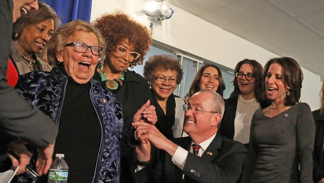 Senate Majority Leader Loretta Weinberg is happy to receive a pen from newly inaugurated Gov. Phil Murphy after he signed an executive order requiring equal pay for women. Weinberg said it was the first bill-signing pen she had received in eight years.