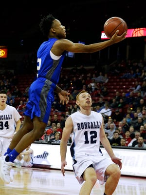 Destiny's Romaine Robinson drives to the basket for a score Thursday in Madison.