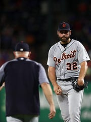 Detroit Tigers manager Ron Gardenhire walks out to