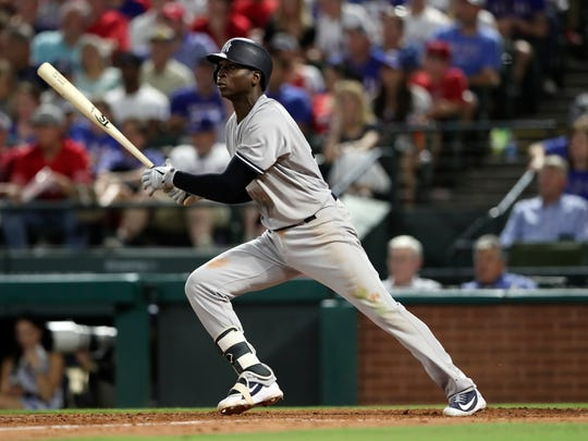 New York Yankees shortstop Didi Gregorius hits an RBI double during the sixth inning  against the Texas Rangers at Globe Life Park in Arlington.