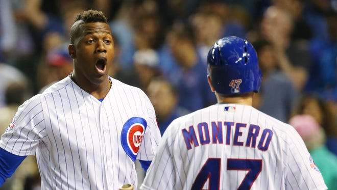 Cubs left fielder Jorge Soler celebrates with catcher Miguel Montero after hitting a two-run home run against the Brewers.