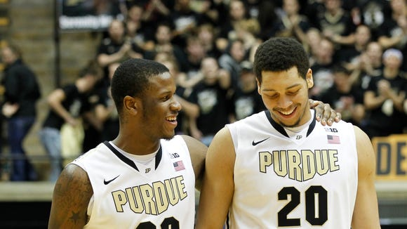Jay Simpson puts his arm around teammate A.J. Hammons moments after Purdue's 65-64 victory over Penn State Saturday, January 18, 2014, in Mackey Arena on the campus of Purdue University. Hammons hit the first of two free throws with 1.1 seconds remaining to seal the Purdue victory.