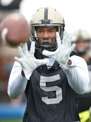 Wide receiver Domonique Young with a catch during spring football practice Wednesday, March 9, 2016, at Purdue University.