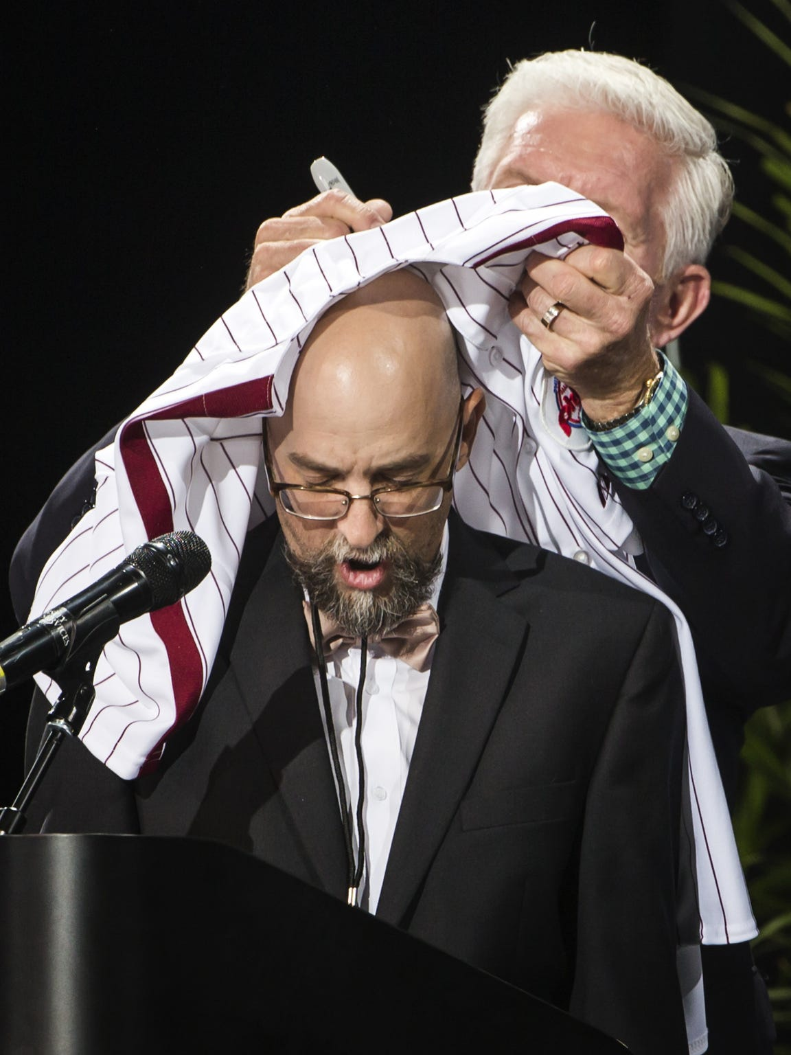 Mike Schmidt signs a jersey on top of The News Journal's Sports and Engagement  Editor, Jason Levine's head at the Delaware Sports Awards banquet at the Bob Carpenter Center at the University of Delaware in Newark on Wednesday evening.