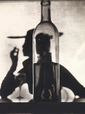 "Irving Penn, ""Girl Behind Bottle (Jean Patchett)"", New York, 1949, printed 1978. Smithsonian American Art Museum, Gift of the artist."