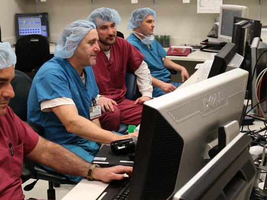 Alison Senter undergoes a cardiac procedure, using a Stereotaxis robot, that will cure her atrial fibrillation. Dr. Raffaele Corbisiero (2nd from left), an electrophysiologist at Deborah Hospital, leads a team that performs the procedure  —January 15, 2016-Browns Mills, NJ.-Staff photographer/Bob Bielk/Asbury Park Press
