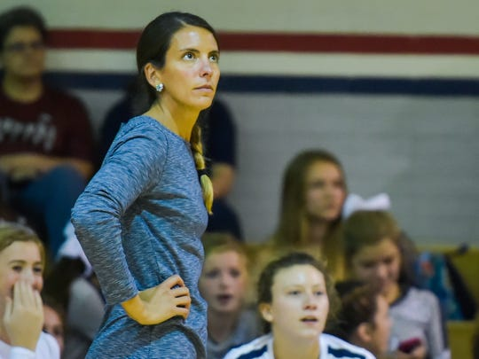 STM volleyball coach Jessica Burke looks on as the Cougars face Teurlings this season.