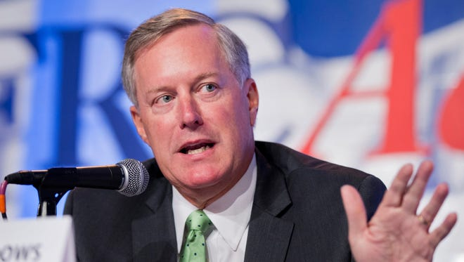 In this Sept. 26, 2014, file photo, Rep. Mark Meadows, R-North Carolina, speaks in Washington. No government shutdown this year, Republican congressional leaders say. But with Congress, it's never easy. Conservatives are demanding a cutoff of Planned Parenthood's federal funds as their price for keeping agencies functioning beyond Sept. 30. A look at what's complicating the effort to avoid a shutdown.