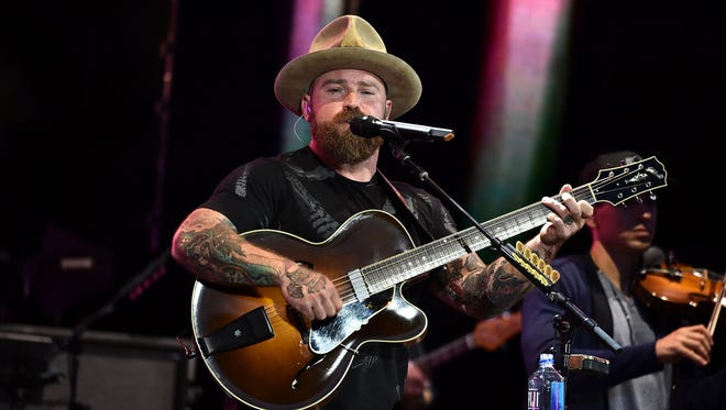 """Zac Brown performs during the """"Down The Rabbit Hole"""" Tour in Boston at Fenway Park, June 15, 2018."""