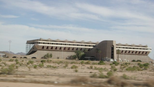 Several readers suggested the famous horse track that is visible south of I-10 off Citrus Road in Goodyear. It was built in 1965, but its developers went bankrupt and liquidated it a year later. A New York-based racetrack and food concession-firm bought it in the late 1960s and operated it as the Arizona Equestrian Center until the mid 1990s.