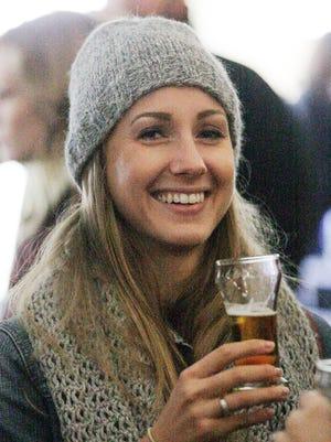 Courtney Crawford of Glendale smiles as she samples a craft beer Saturday October 18, 2014 at Blue Harbor Resort's Craft Beer Festival in Sheboygan.