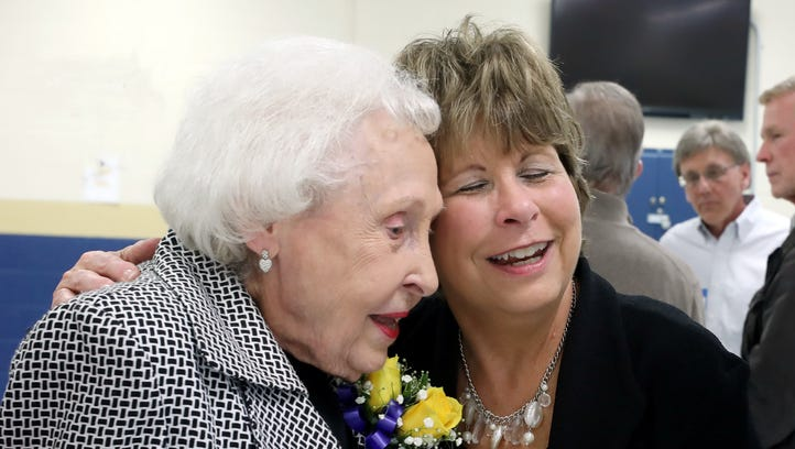 96-year-old retired teacher surprised by a dozen students she taught in the 1960s